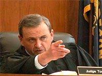 Суддя Томас Харт засудив українських батьків на 7 років